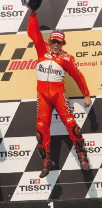 Loris Capirossi jumps for joy at Motegi