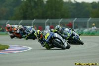 The 2005 MotoGP field streams through